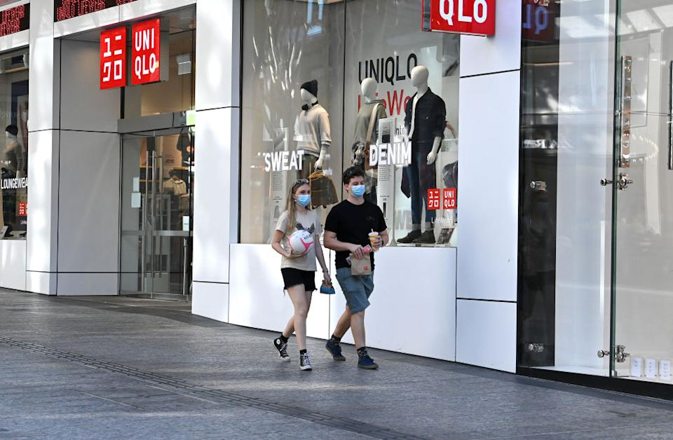 People are seen wearing face masks on the Queen Street Mall in the Brisbane CBD.
