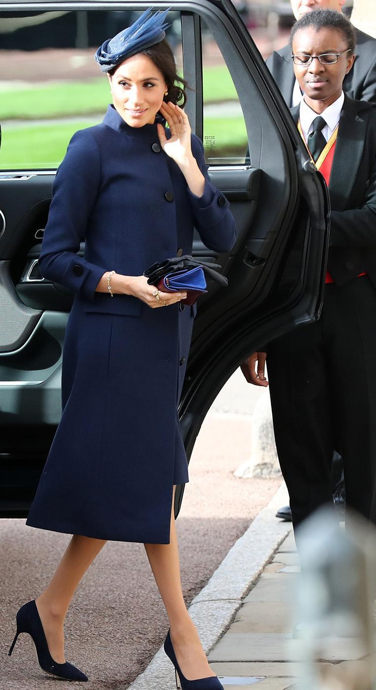 Meghan Markle accessorised with a navy hat and clutch bag. [Photo: Twitter]