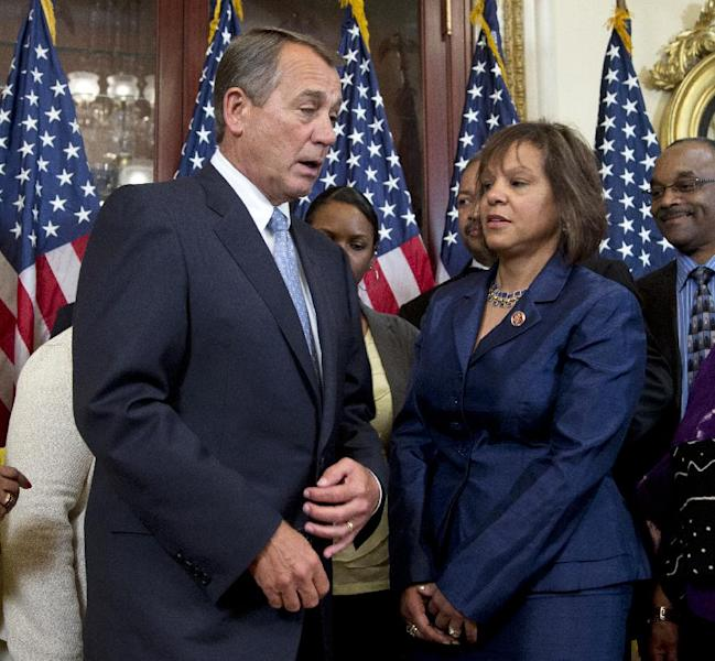 Rep. Robin Kelly, D-Ill. talks with House Speaker John Boehner of Ohio before participating in her ceremonial swearing-in ceremony, Thursday, April 11, 2013, on Capitol Hill in Washington. Earlier Kelly was officially sworn in on the House floor. She takes over the seat held for 17 years by scandal-tarnished Jesse Jackson Jr. (AP Photo/Manuel Balce Ceneta)