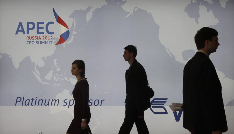 Delegates arrive on the opening morning of presentations at the APEC summit in Vladivostok, Russia, Friday, Sept. 7, 2012. (AP Photo/Ahn Young-joon)
