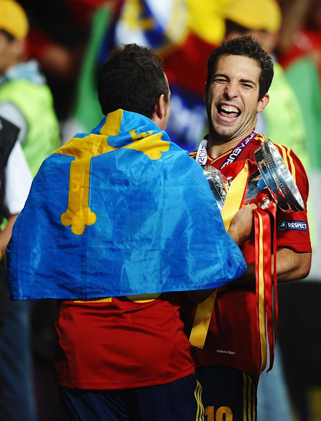 KIEV, UKRAINE - JULY 01: Jordi Alba (R) and Santi Cazorla of Spain celebrate with the trophy following their team's victory during the UEFA EURO 2012 final match between Spain and Italy at the Olympic Stadium on July 1, 2012 in Kiev, Ukraine. (Photo by Laurence Griffiths/Getty Images)