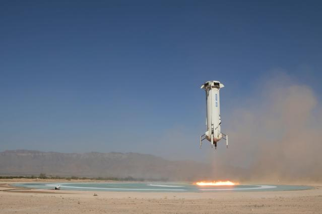 In this photo provided by Blue Origin, The booster of the New Shepard rocket prepares to land in a project called Mission 9 (M9) in western Texas on Wednesday, July 18, 2018. Jeff Bezos' Blue Origin rocket company shot a capsule higher into space Wednesday than it's ever done before. (Blue Origin via AP)