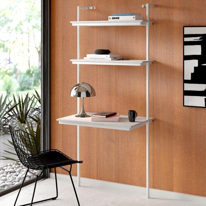 """<h3>AllModern Highline Leaning Ladder Bookcase<br></h3><br>Always fantasized about having a home office, but figured your small apartment rendered that idea impossible? Meet the compact ladder-bookshelf meets desktop workstation that's here to change that — with a streamlined wall-mountable wink. <br><br><strong>AllModern</strong> Highline Leaning/Ladder Desk, $, available at <a href=""""https://go.skimresources.com/?id=30283X879131&url=https%3A%2F%2Fwww.allmodern.com%2Ffurniture%2Fpdp%2Fhighline-leaningladder-desk-a000025875.html"""" rel=""""nofollow noopener"""" target=""""_blank"""" data-ylk=""""slk:AllModern"""" class=""""link rapid-noclick-resp"""">AllModern</a>"""