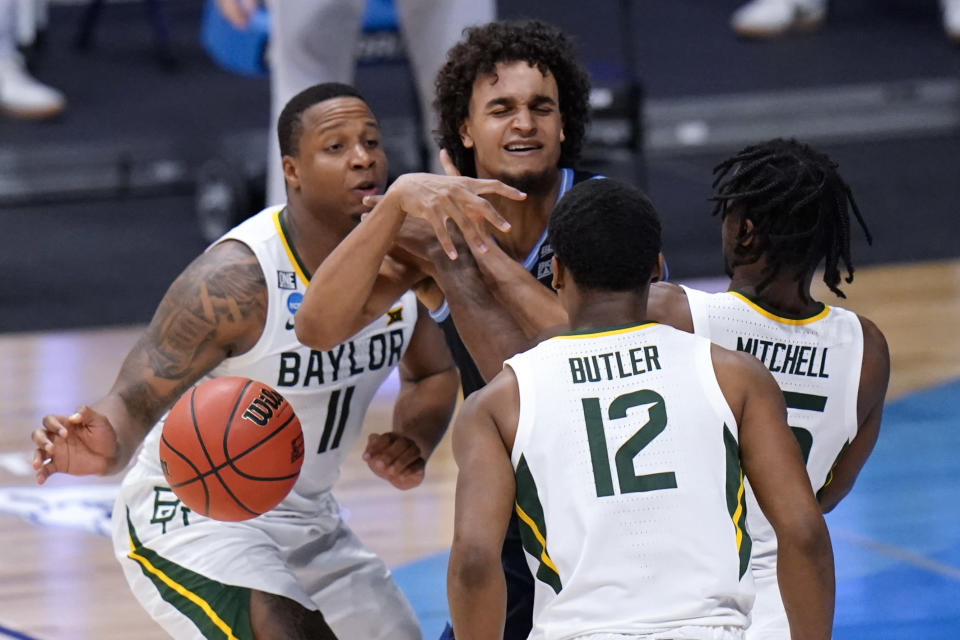Villanova forward Jeremiah Robinson-Earl (24) loses the ball against Baylor guard Mark Vital (11), Davion Mitchell (45) and Jared Butler (12) in the second half of a Sweet 16 game in the NCAA men's college basketball tournament at Hinkle Fieldhouse in Indianapolis, Saturday, March 27, 2021. (AP Photo/AJ Mast)