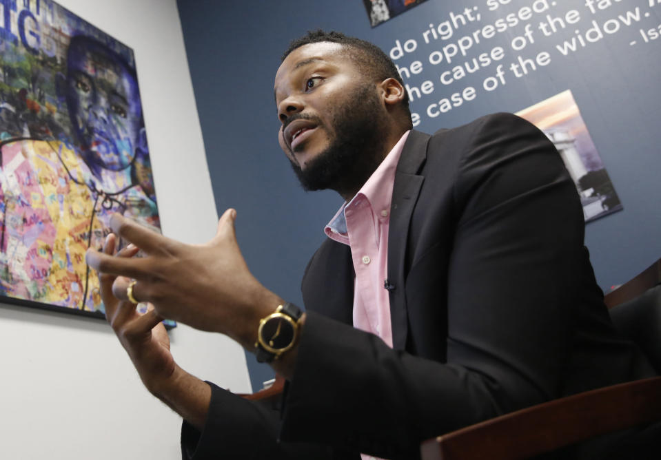 FILE - In this Aug. 14, 2019, file photo, then-Stockton Mayor Michael Tubbs speaks during an interview in Stockton, Calif. A study of people in California who received $500 a month for free says they used it to pay off debt and get full-time jobs. A pair of independent researchers reviewed data from the first year of the study and released their finding on Wednesday, March 3, 2021. Run by a nonprofit founded by Tubbs, the program gave $500 a month to 125 people who lived in census tracts at or below the city's median household income of $46,033. (AP Photo/Rich Pedroncelli, File)