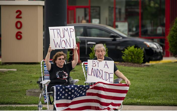 Supporters repeated Mr Trump's false claim that he won the election outside the Greenville Convention Center - Tasos Katopodis/UPI/Shutterstock