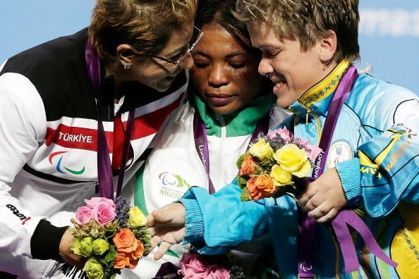Silver medallist Cigdem Dede of Turkey, gold medallist Ivory Nwokorie of Nigeria and bronze medallist Lidiia Soloviova of Ukraine react on the podium during the medal ceremony for the women's -44kg powerlifting competition on day 2 of the London 2012 Paralympic Games at ExCel on August 31, 2012 in London, England. (Photo by Matthew Lloyd/Getty Images)