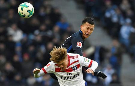 Soccer Football - Bundesliga - Hamburger SV vs Hertha BSC - Volksparkstadion, Hamburg, Germany - March 17, 2018 Hamburg's Gotoku Sakai in action with Hertha Berlin's Davie Selke REUTERS/Fabian Bimmer