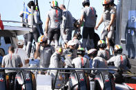 Italy's Luna Rossa team members celebrate their defeat of Team New Zealand in race 5 of the America's Cup on Auckland's Waitemata Harbour, New Zealand, Saturday, March 13, 2021. (Chris Cameron/Photosport via AP)