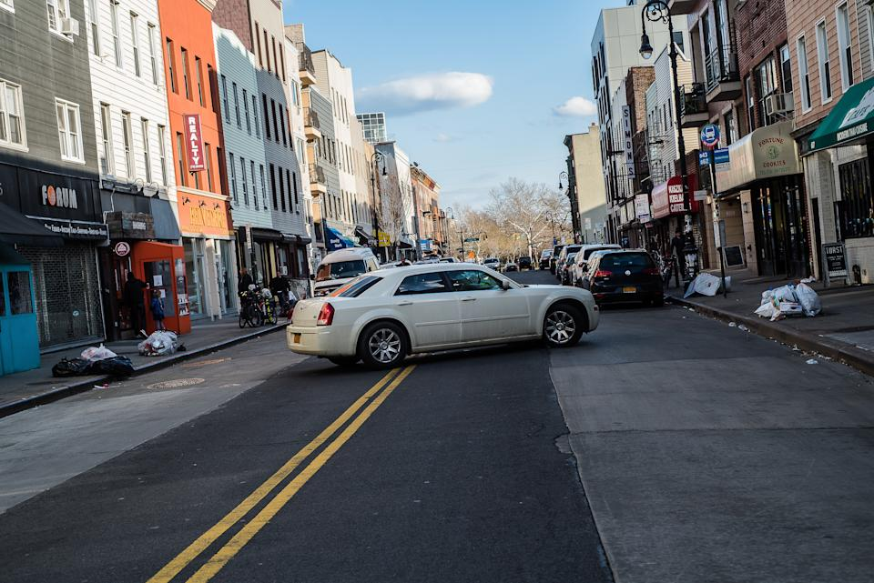 Car performing u-turn in the street. Source: Getty Images