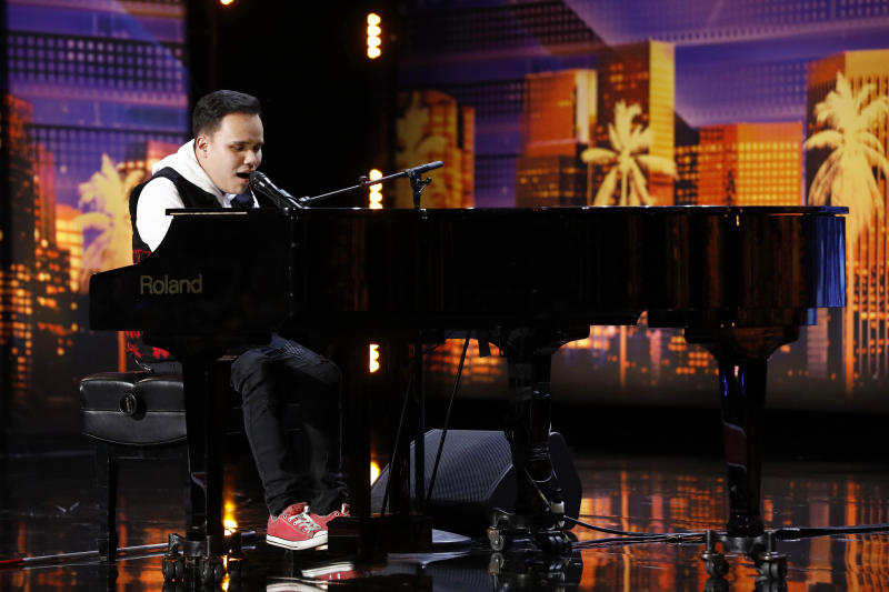 "This Tuesday, May 28, 2019 photo provided by NBC shows Kodi Lee during his original audition performing on NBC's ""America's Got Talent"" in Pasadena, Calif. Lee singing a version of ""A Song For You"" has been viewed nearly 432 million times online, NBC said.  (Trae Patton/NBC via AP)"