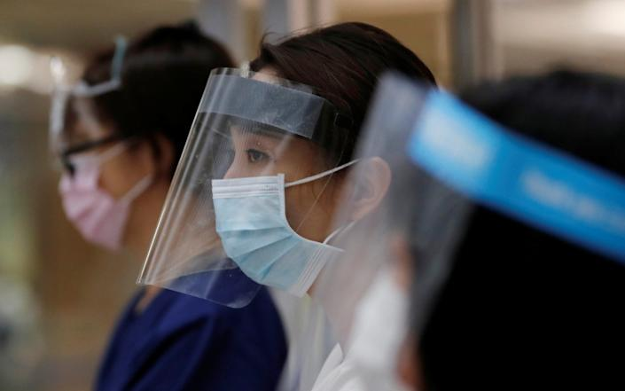 Hospital staff in Japan have had their bonuses cut despite the coronavirus outbreak - KIM KYUNG-HOON/REUTERS