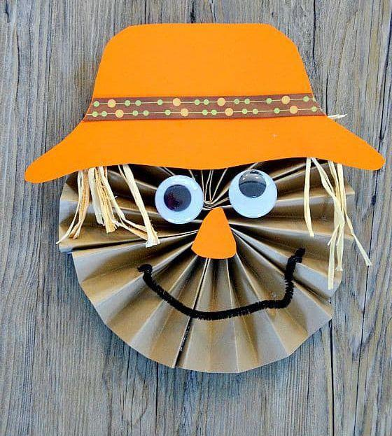 """<p>This scarecrow craft is not really going to scare anybody (and we love him all the more for it). You can use leftover raffia from gift baskets as the hair.</p><p><em><a href=""""https://meaningfulmama.com/scarecrow-paper-craft-for-kids.html"""" rel=""""nofollow noopener"""" target=""""_blank"""" data-ylk=""""slk:Get the tutorial at Meaningful Mama »"""" class=""""link rapid-noclick-resp"""">Get the tutorial at Meaningful Mama »</a></em></p><p><strong>RELATED:</strong> <a href=""""https://www.goodhousekeeping.com/holidays/thanksgiving-ideas/g2907/thanksgiving-kids-crafts/"""" rel=""""nofollow noopener"""" target=""""_blank"""" data-ylk=""""slk:Easy Thanksgiving Crafts for Kids That'll Make Their Holiday More Fun"""" class=""""link rapid-noclick-resp"""">Easy Thanksgiving Crafts for Kids That'll Make Their Holiday More Fun</a></p>"""