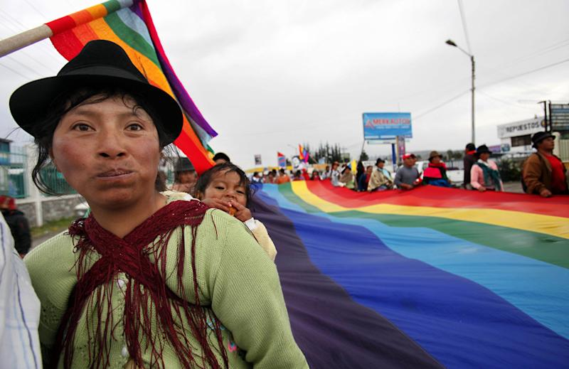 Indigenous demonstrators march during a protest in Latacunga, Ecuador, Monday, March 19, 2012. Several hundred Indians began on March 8 a two-week march to Quito to protest against mining exploitation on their traditional lands. (AP Photo/Dolores Ochoa)