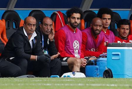 Soccer Football - World Cup - Group A - Egypt vs Uruguay - Ekaterinburg Arena, Yekaterinburg, Russia - June 15, 2018 Egypt's Mohamed Salah and teammates on the bench during the match REUTERS/Andrew Couldridge