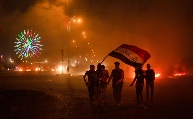 Protesters in Basra late on Wednesday -- the city is one of several southern urban centres hit by reinvigorated protests, in part due to the provincial governor being touted as the next prime minister (AFP Photo/Hussein FALEH)
