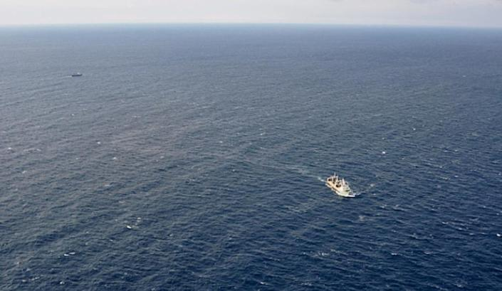 This handout picture taken and released by Russia's Emergency Ministry on April 2, 2015 shows ships carrying out a search operation in the Sea of Okhotsk where the trawler Dalny Vostok sank (AFP Photo/)