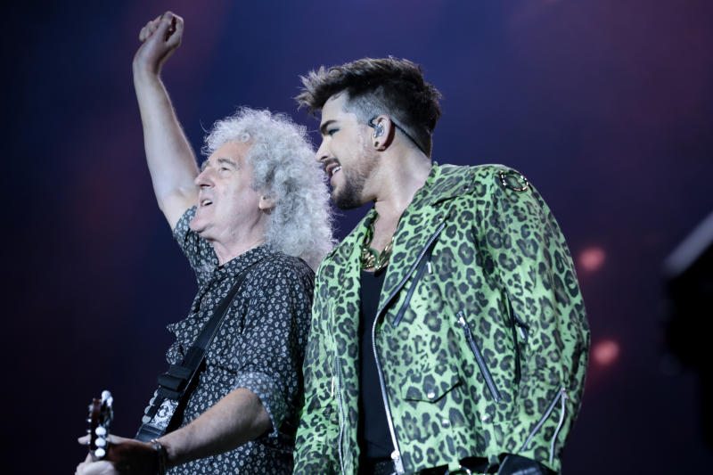 May (left) still performs with Queen + Adam LambertGetty Images