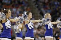 Duke cheerleaders perform during the first half of an NCAA college basketball second-round game against Mercer , Friday, March 21, 2014, in Raleigh, N.C. (AP Photo/Chuck Burton)