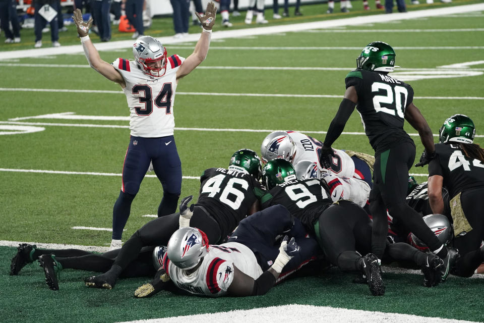 New England Patriots' Rex Burkhead, left, signals a touchdown as quarterback Cam Newton scores during the second half of an NFL football game against the New York Jets, Monday, Nov. 9, 2020, in East Rutherford, N.J. (AP Photo/Corey Sipkin)