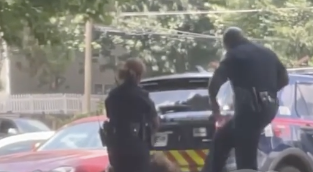 Bystander video shows an Atlanta police officer allegedly kicking a handcuffed woman in the face on Monday afternoon. (Screengrab via ATLUncensored)