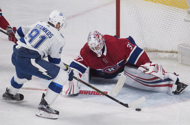 Tampa Bay Lightning center Steven Stamkos (91) moves in against Montreal Canadiens goaltender Antti Niemi (37) during third-period NHL hockey game action in Montreal, Saturday, Feb. 24, 2018. (Graham Hughes/The Canadian Press via AP)