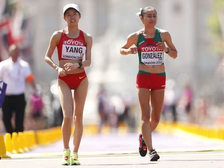 Athletics - World Athletics Championships – women's 20 km walk – London Stadium, London, Britain – August 13, 2017 – Jiayu Yang of China and Maria Guadalupe Gonzalez of Mexico react after wining gold and silver medals. REUTERS/Matthew Childs