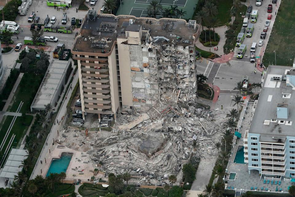 This aerial photo shows part of the 12-story oceanfront Champlain Towers South Condo that collapsed early Thursday, June 24, 2021 in Surfside, Fla.