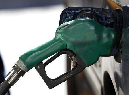 A gas nozzle is used to pump petrol at a station in New York