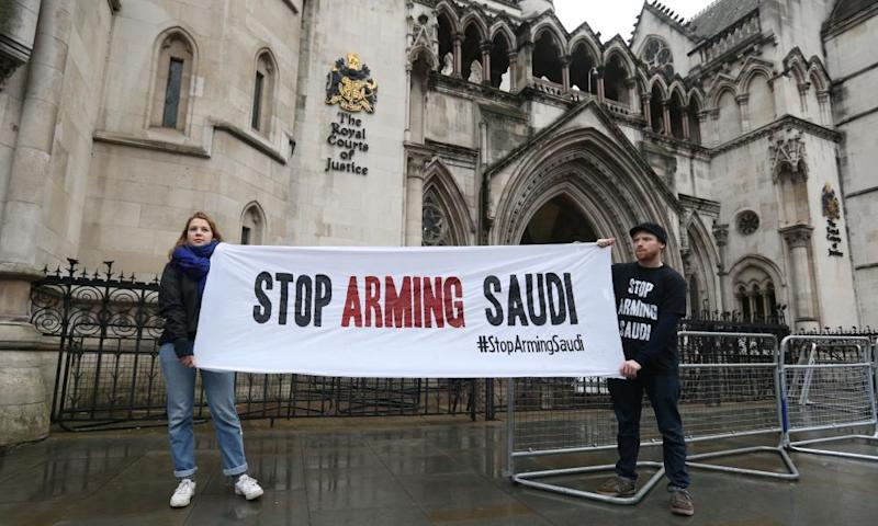 Campaigners hold a banner outside the high court in central London where the legality of UK arms exports to Saudi Arabia is under challenge.