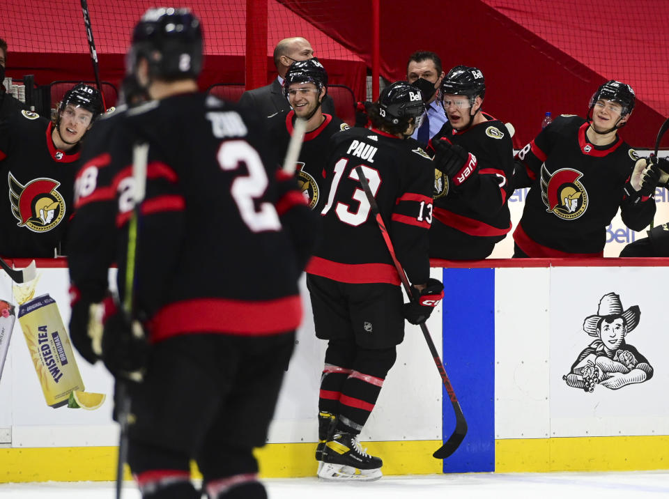 Ottawa Senators' Nick Paul celebrates a goal with the bench against the Montreal Canadiens during the third period of an NHL hockey game, Wednesday, May 5, 2021 in Ottawa, Ontario. (Sean Kilpatrick/The Canadian Press via AP)