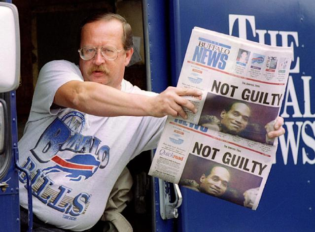 "<p>Newspaper delivery truck driver Jim Janiszeski shows off the late edition of the Oct. 3, 1995, ""Buffalo News"" displaying the headline of the day, the verdict of not guilty for former Buffalo Bills star running back O.J .Simpson. (Photo: Joe Traver/Reuters) </p>"