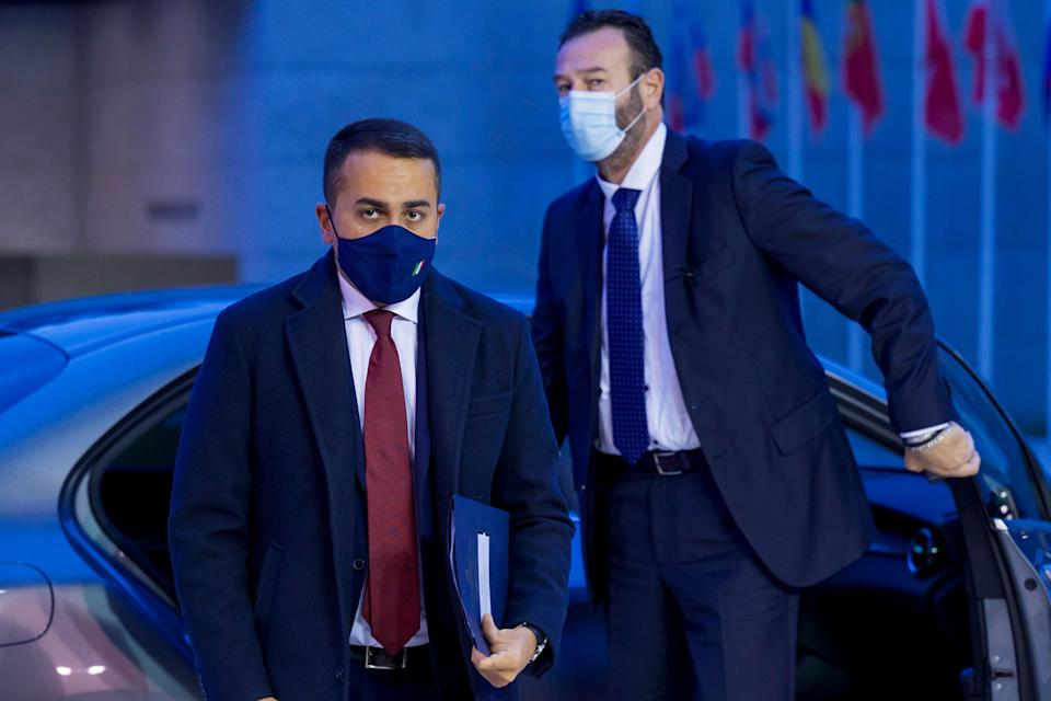 Italy's Foreign Minister Luigi Di Maio, left, arrives for a meeting of European Union foreign ministers at the European Council building in Luxembourg, Monday, Oct. 12, 2020. European Union foreign ministers were weighing Monday whether to impose sanctions on Russian officials and organizations blamed for the poisoning of opposition leader Alexei Navalny with a Soviet-era nerve agent. (Jean-Christophe Verhaegen, Pool via AP) (Photo: ASSOCIATED PRESS)