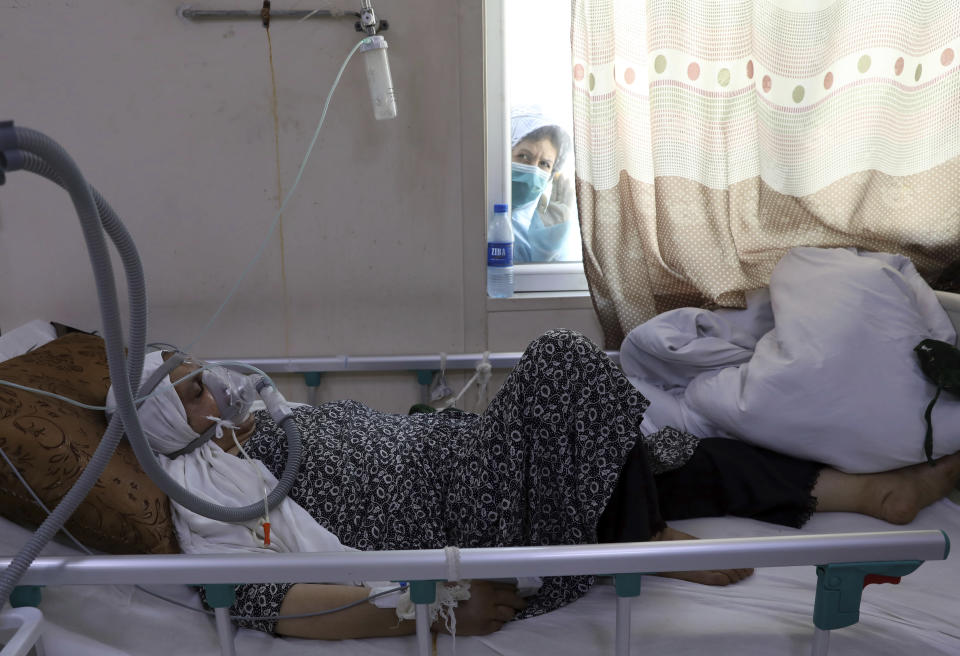 A patient is connected to oxygen tank in the intensive care unit ward for COVID-19 patients at the Afghan-Japan Communicable Disease Hospital in Kabul, Afghanistan, Sunday, May 30, 2021. Afghanistan is battling a brutal third wave of COVID infections, while health officials plead for vaccines, expressing deep frustration at the inequities of the global vaccine distribution. Positive COVID cases jump from eight percent to 60 per cent in some parts of the country. (AP Photo/Rahmat Gul)