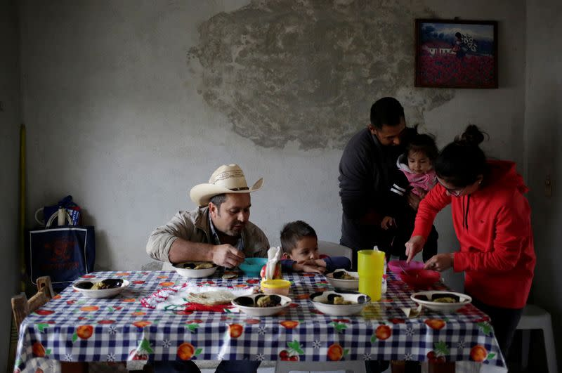 Jesus Mendoza 35, Mariela Ramirez 28 and their daughter Victoria 1, eat a meal with relatives in Jalpan de Serra