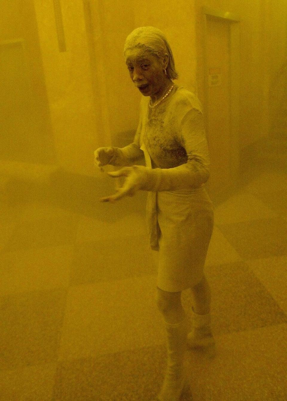 Marcy Borders stands covered in dust as she takes refuge in an office building following the collapse of the Twin Towers (AFP/Getty)