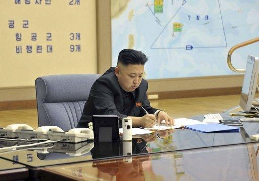 North Korean leader Kim Jong-Un signs documents at an undisclosed location on March 29, 2013