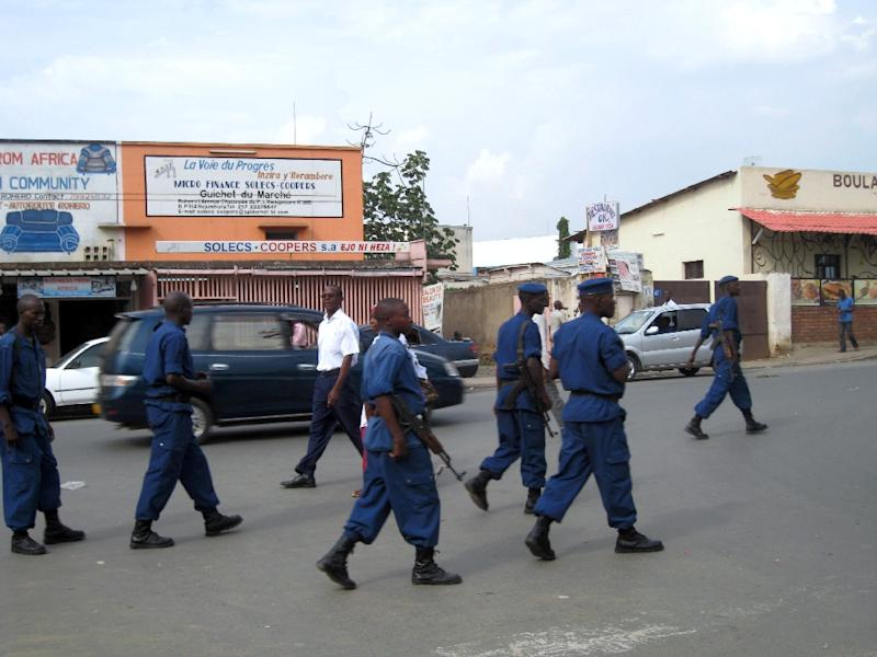 File photo shows police patrolling a street in Bujumbura on September 26, 2013