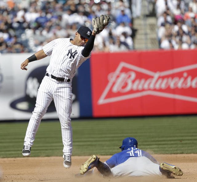 Toronto Blue Jays' Kevin Pillar, right, steals second past New York Yankees second baseman Gleyber Torres during the seventh inning of a baseball game at Yankee Stadium, Sunday, April 22, 2018, in New York. (AP Photo/Seth Wenig)