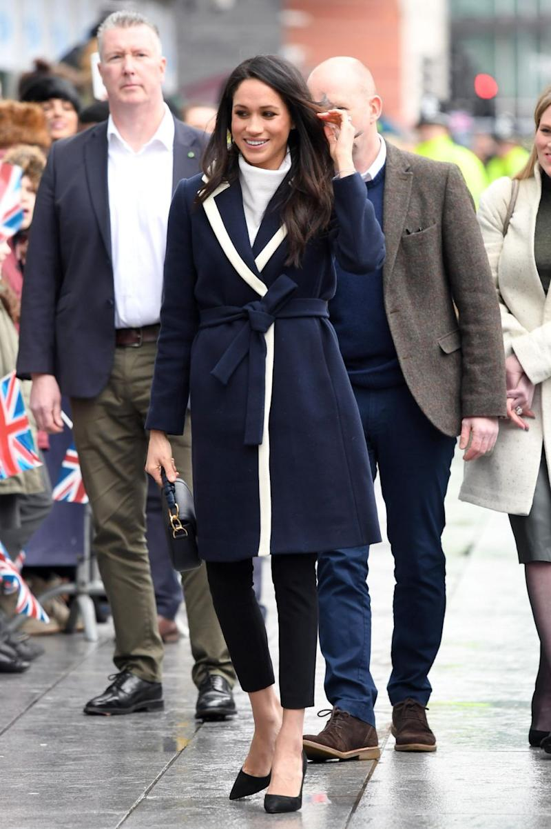 She matched the $500 coat with a pair of Alexander Wang trousers and a crisp white All Saints turtleneck jumpers. Photo: Getty Images