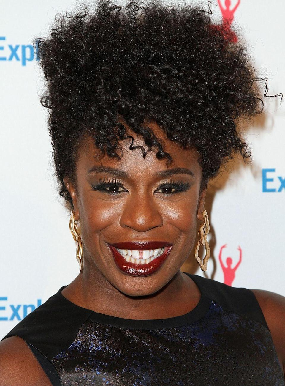 """<p>Play up natural tendrils with actress <strong>Uzo Aduba</strong>'s romantic all-on-top style that looks great with <a href=""""https://www.goodhousekeeping.com/beauty/makeup/tips/g2329/best-drugstore-cosmetics/"""" rel=""""nofollow noopener"""" target=""""_blank"""" data-ylk=""""slk:daring makeup"""" class=""""link rapid-noclick-resp"""">daring makeup</a> and fun jewelry.</p>"""
