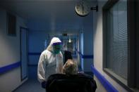 A nurse talks with a patient in the COVID-19 ward of Cascais Hospital amid the coronavirus disease (COVID-19) pandemic in Cascais