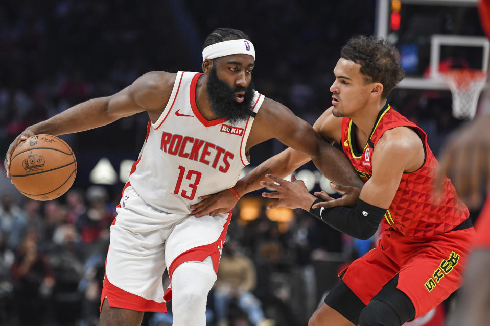 Jan 8, 2020; Atlanta, Georgia, USA; Houston Rockets guard James Harden (13) is defended by Atlanta Hawks guard Trae Young (11) during the first half at State Farm Arena. Mandatory Credit: Dale Zanine-USA TODAY Sports