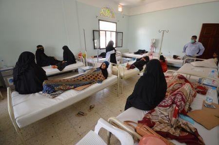 FILE PHOTO: Women sit with relatives infected with cholera at a hospital in the Red Sea port city of Hodeidah, Yemen May 14, 2017. REUTERS/Abduljabbar Zeyad
