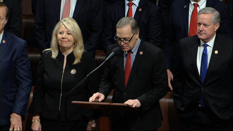 Rep. Andy Biggs, R-Ariz., makes a motion for the House to adjourn as the House of Representatives debates the articles of impeachment against President Donald Trump at the Capitol in Washington, Wednesday, Dec. 18, 2019. At left is Rep. Debbie Lesko, R-Ariz., and at right is Rep. Mark Meadows, R-N.C. (House Television via AP)