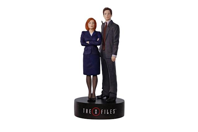 "<p>Put Scully and Mulder on the Christmas case with this figurine ornament that also plays the show's spooky theme song. The truth is out there (about what you're getting this year). <strong><a href=""https://www.hallmark.com/ornaments/keepsake-ornaments/the-x-files-scully-and-mulder-musical-ornament-1795QXI1505.html"" rel=""nofollow noopener"" target=""_blank"" data-ylk=""slk:Buy here"" class=""link rapid-noclick-resp"">Buy here</a></strong> </p>"