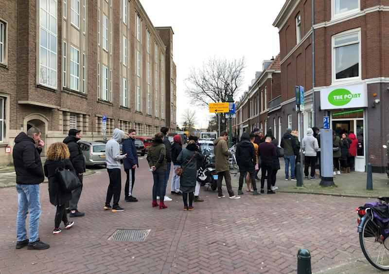 "People queue outside a cannabis coffee shop on March 15, 2020, in The Hague, after the Dutch government ordered the closing of all schools, bars, restaurants, sex clubs and cannabis cafes in a bid to fight the spread of COVID-19, the new coronavirus. - Queues quickly built up at ""coffee shops"" where cannabis is sold after the announcement, which follows pressure on the government to follow the lead of other European countries. (Photo by Danny KEMP / AFP) (Photo by DANNY KEMP/AFP via Getty Images)"