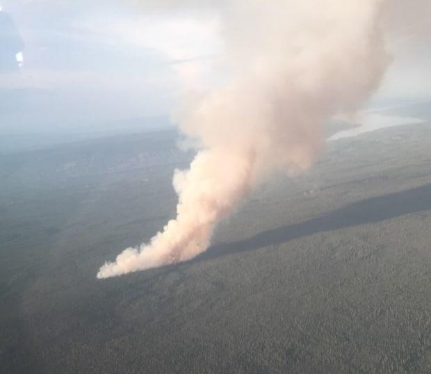 A wildfire burning in Yukon in July. Fire officials said there were 69 wildfires burning in the territory on Monday. (Yukon Protective Services/Twitter - image credit)