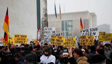 FILE PHOTO: Activists and supporters of the 'International Convention of German Russians'  protest against sexual harassement by migrants in front of the Chancellery in Berlin