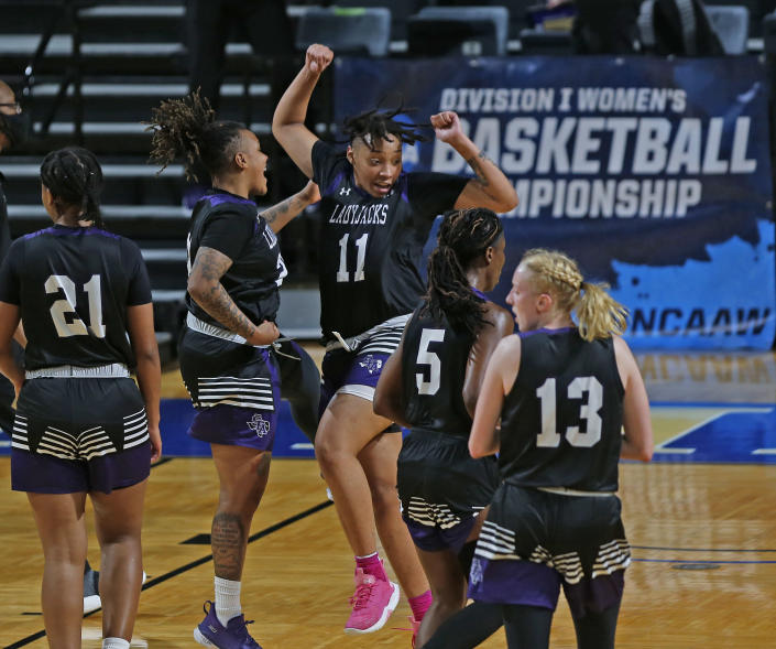 Stephen F. Austin forward Avery Brittingham (11) celebrates at the end of the first half of a college basketball game in the first round of the women's NCAA basketball tournament at the Greehey Arena in San Antonio, Texas, Sunday, March 21, 2021. (AP Photo/Ronald Cortes)